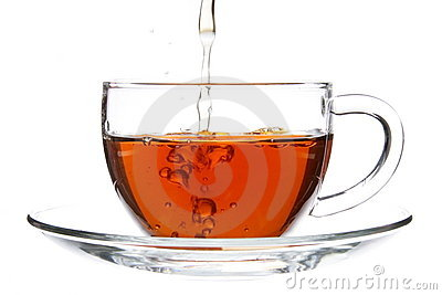 Pouring Tea into Cup with Splash