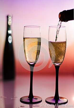 Free Pouring Two Champagne Toast Cups Stock Photography - 35551332