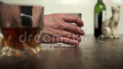Pouring whiskey in two glasses stock video footage