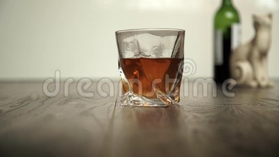 Pouring whiskey in two glasses stock footage