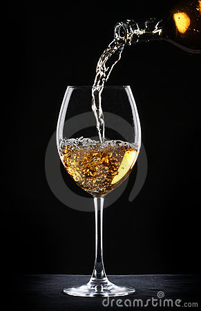Free Pouring White Wine Into A Glass Stock Images - 16931294