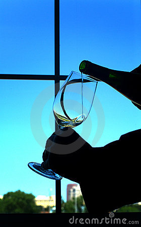 Pouring wine in a glass