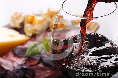 Pouring wine into glass and food