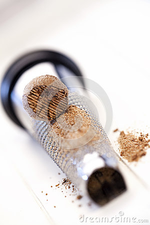 Powder and nutmeg on a grater