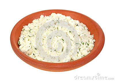 Powdered ricotta cheese with herbs in small bowl