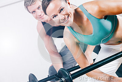 Power gymnastics with barbells in gym