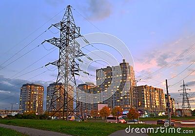 Power line feeding the evening city.