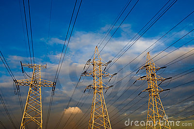 Power line pole over blue sky background
