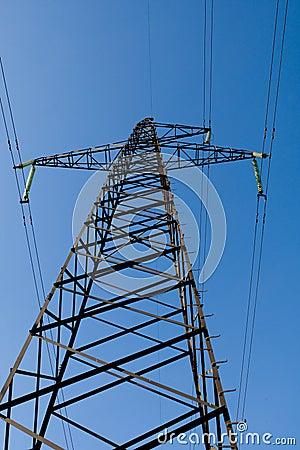 Power line poles over blue sky background