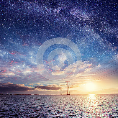 Free Power Lines Over Water At Night. Mysterious Starry Sky. Cumulus Royalty Free Stock Photo - 86119135