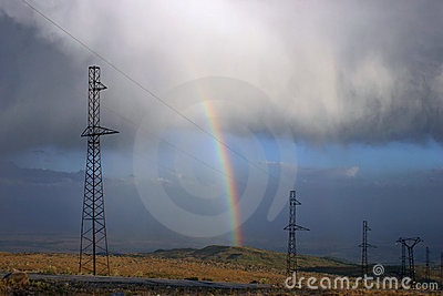 Power lines with rainbow