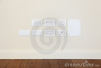 power outlet and light switch on the wall royalty free stock photo image 22446455