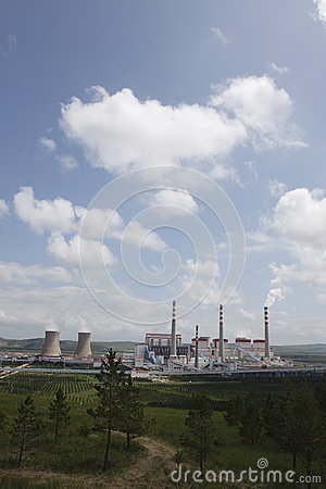 Power plants, cooling towers, chimneys, grassland