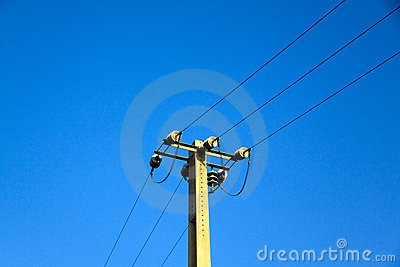 Power pole against the blue sky