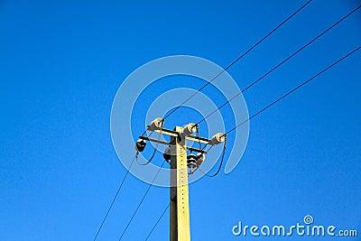 Power pole against the blue sky