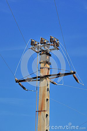 Power pole with external electric separator on top Stock Photo