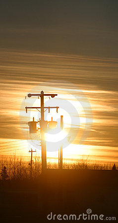 Power pole in silhouette