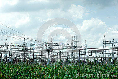 Power post  with grass and sky