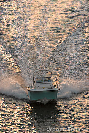 Powerboat at sunset