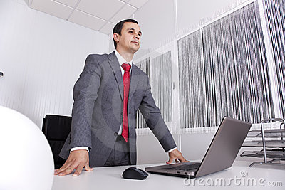 Powerful businessman working at the office