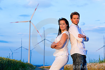 Powerful couple in front of windmill
