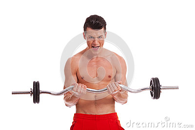 Powerful muscular man with a barbell in hands