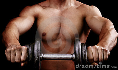 Powerful muscular man holding workout weight