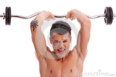 Powerful muscular man lifting weights