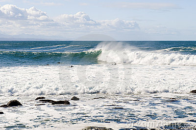Powerful waves and surfers