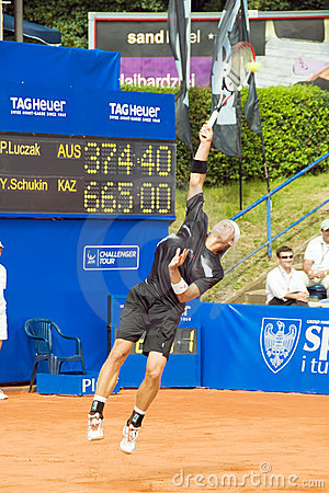 Poznan Porshe Open 2009 - P.Luczak (AUS) Serving Royalty Free Stock Photo - Image: 10307445