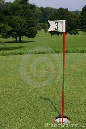 Free Practice Golf Putting Hole Backed Up To Golf Course Royalty Free Stock Photo - 60075