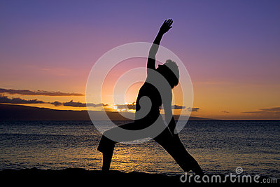 Practicing Yoga at Sunset