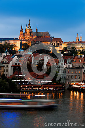 Prague Castle across the river in the evening