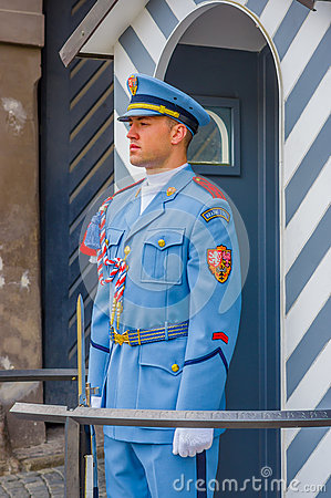 Free Prague, Czech Republic - 13 August, 2015: Palace Guard On Duty Wearing His Distinctive Blue Uniforms, White Striped Royalty Free Stock Photos - 65696298