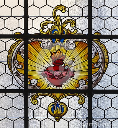 Free PRAGUE, CZECH REPUBLIC - OCTOBER 16, 2018: The Baroque Heart Of Virgin Mary In The Stained Glass In Church Kostel Svatého Havla Stock Image - 137517311