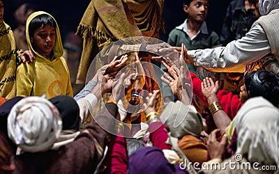 Prasad contribution during Ganga Aarti ceremony Editorial Photo