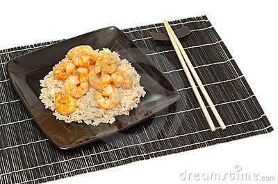 Prawns and fried rice on a mat