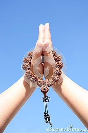 Prayer beads in her hands