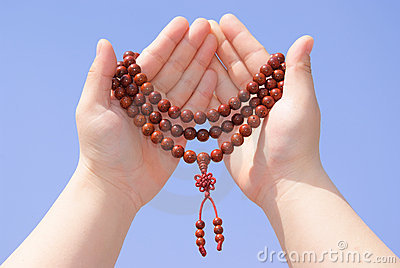 Prayer beads in her hands