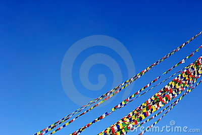 Prayer flag cords under blue sky
