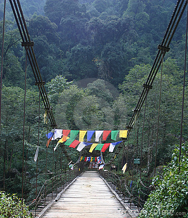 Prayer flags across a bridge, northeast India