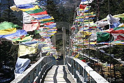 Prayer flags across a bridge Sikkim, India