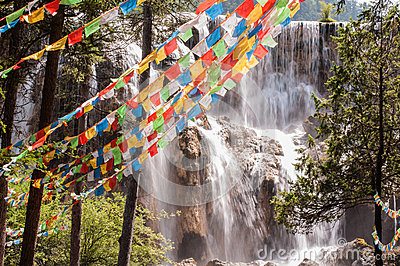 Prayer flags in front of the waterfall