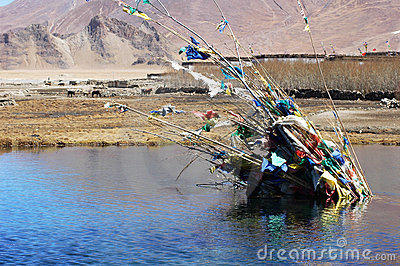 Prayer flags in a lake in tibet
