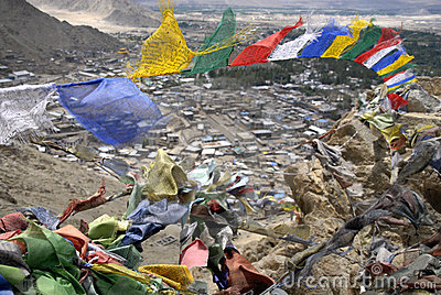 Prayer flags with Leh in the background