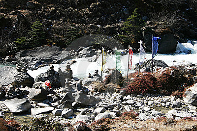Prayer flags and prayer stones along river, Sikkim