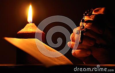 Prayer hands with crucifix