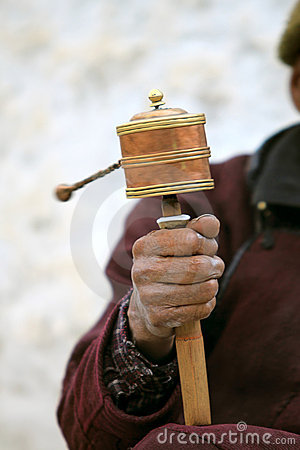 Prayer wheel in man s hand
