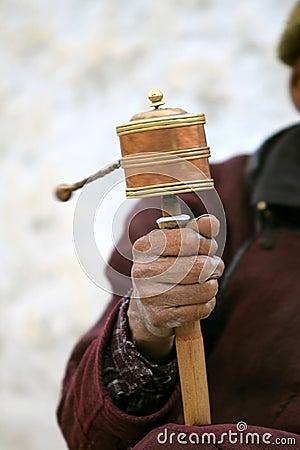 Prayer wheel in man s hand