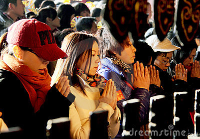 Prayers in Chinese temple Editorial Stock Photo